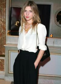 Clémence Poésy effortless pulls off a black bra under a white shirt by matching it with black pants and black handbag and keeping the rest of her look simple